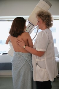 Woman Receiving Breast Exam